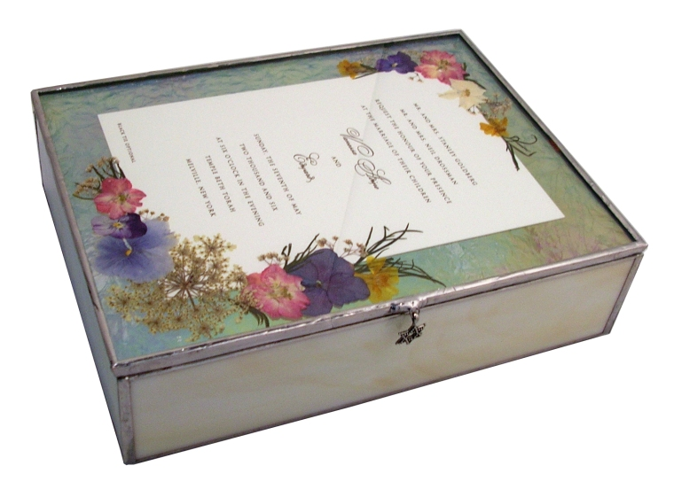 pressed flowers on wedding invitation box